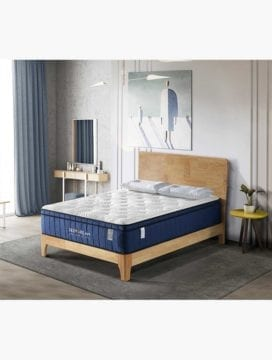 A Deep Dream Premium Memory Foam mattress placed on a wooden bed in a minimalist Australian bedroom