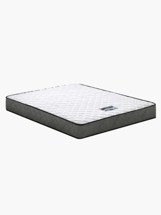 A top side quarter view of the Olsen single mattress with its strong support system