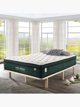 Green tea memory foam mattress laid on a bed in an Australian bedroom filled with windows